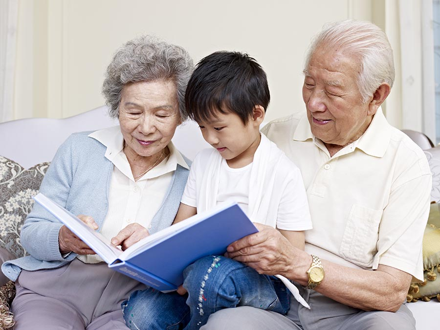 Grandparents reading to children