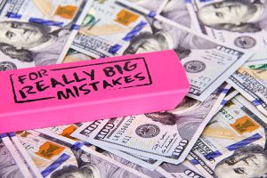 stacks of money lost in divorce mistakes
