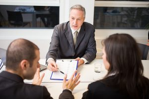 lawyer asking questions to divorcing couple