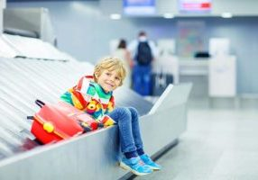 Child Waiting For Parents at Airport Baggage Claim